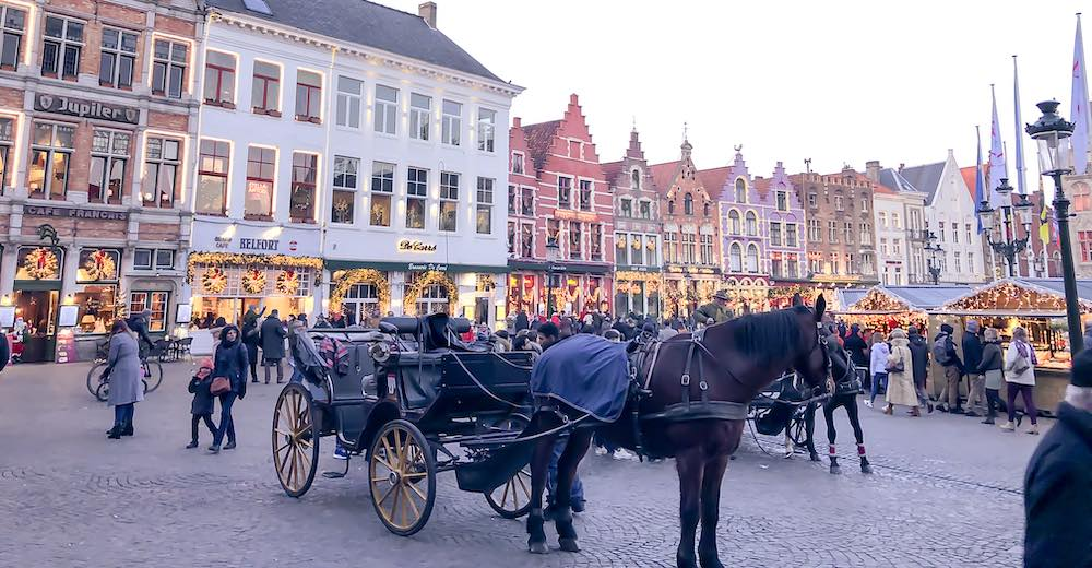 A hors-carriage ride is an essential thing to do when celebrating Christmas in Bruges and attending the most famous of Belgium Christmas markets