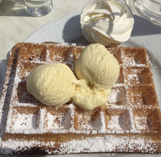 Bruges or Ghent for foodies - Fluffy waffle with scoops of vanilla ice cream in Ghent Belgium