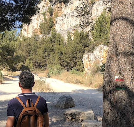 Man hiking the rocky trail in the Calanques National Park in the Provence