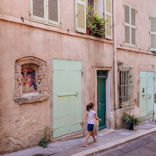 Little girl exploring the streets of Le Panier France Marseille