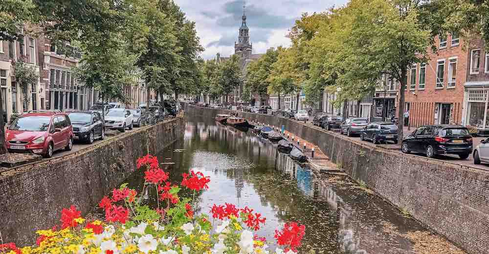 Canal view of Gouda, the city famous for its Dutch cheese market