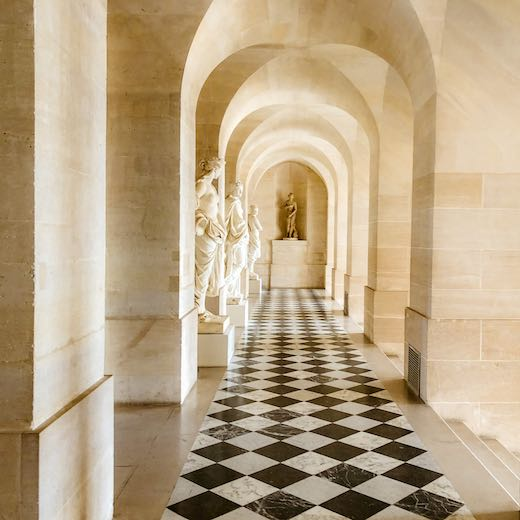 Visit the Marble Courtyard and Lower Gallery during your Versailles tour from Paris