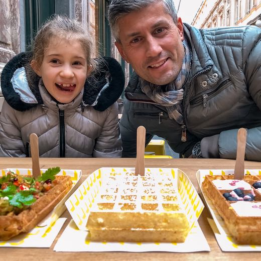 A little girl and her dad ordered waffles during their Brussels 2 day itinerary