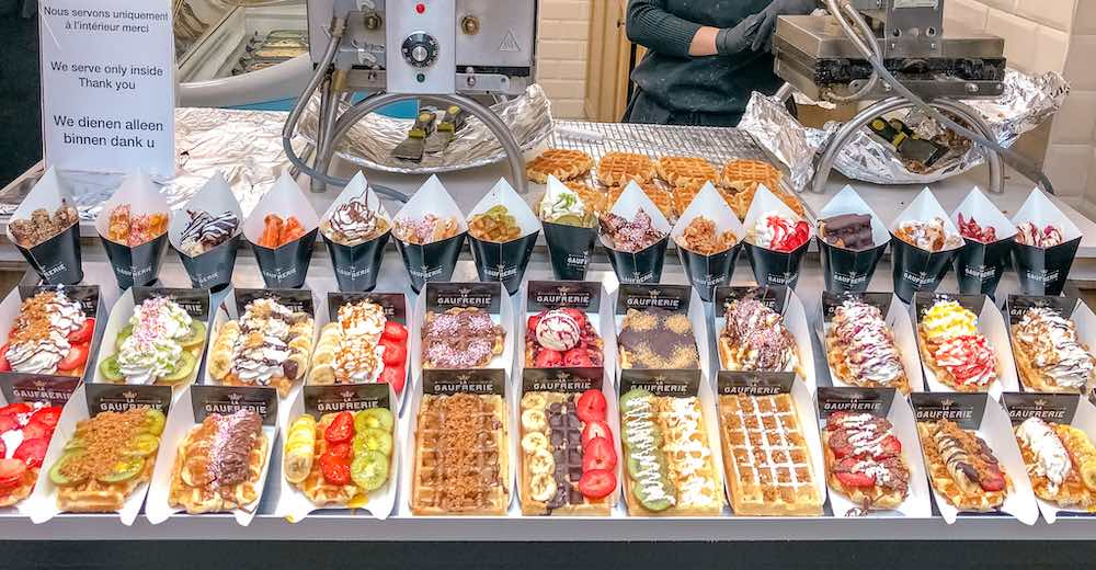 Assortment of waffles in Brussels with many different toppings
