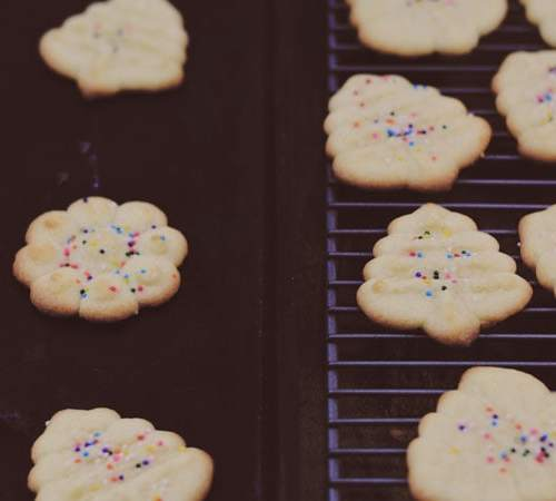 """Spritzgebäck - or """"Spritz Cookies"""" are wonderful little German butter cookies. The recipe is simple, but you can have some creative fun with these and suit them for any special occasion. Get the recipe from Cosmopolitan Cornbread"""