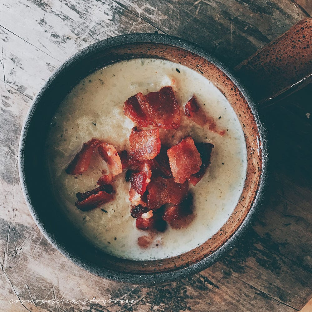 Cauliflower & Bacon Soup is an easy, one pot meal that cooks up in less than an hour. You will love the flavor in this veggie soup. Get this paleo friendly & low carb recipe from Cosmopolitan Cornbread.