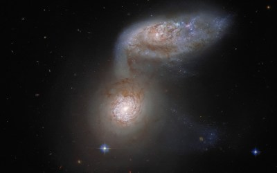 Galaxies Lose Structure in One Another's Arms