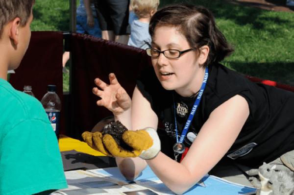 Nicole Gugliucci making model comets at the Edwardsville Route 66 Festival.