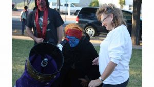 Member of the Astronomers of Verde Valley show a costumed visitor a view of the daytime Moon at the Star Party for Clarkdale Halloween event. Credit: J.D. Maddy