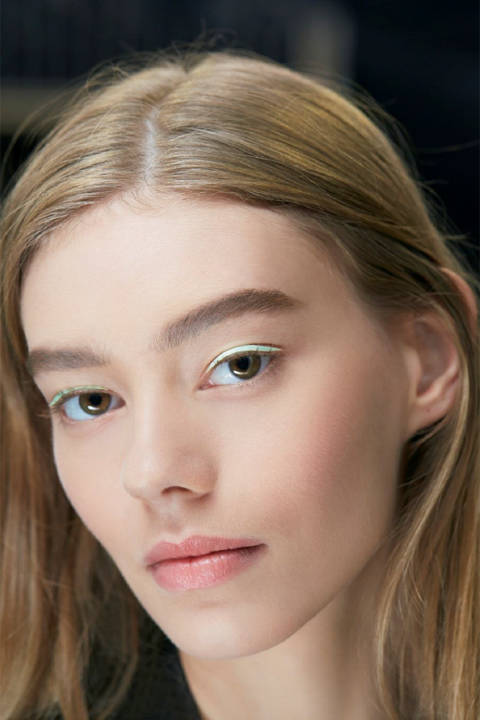 """Peter Philips, Creative and Image Director for Dior Makeup, set a modern trend for delicate expressions of colour next Spring. The """"Pastel Eyes"""" were created using laser-cut patches of satin, in a similar ilk to Fendi's demonstration of leather liner. We love this trend! Stick on material eyeliner as you would falsies with eyelash glue and keep the rest of your makeup natural."""
