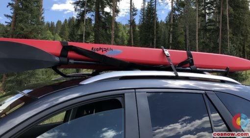 KlikBelt utility strap holding paddleboard on car roof
