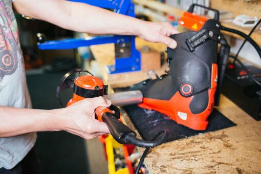 Shop worker performing boot repair