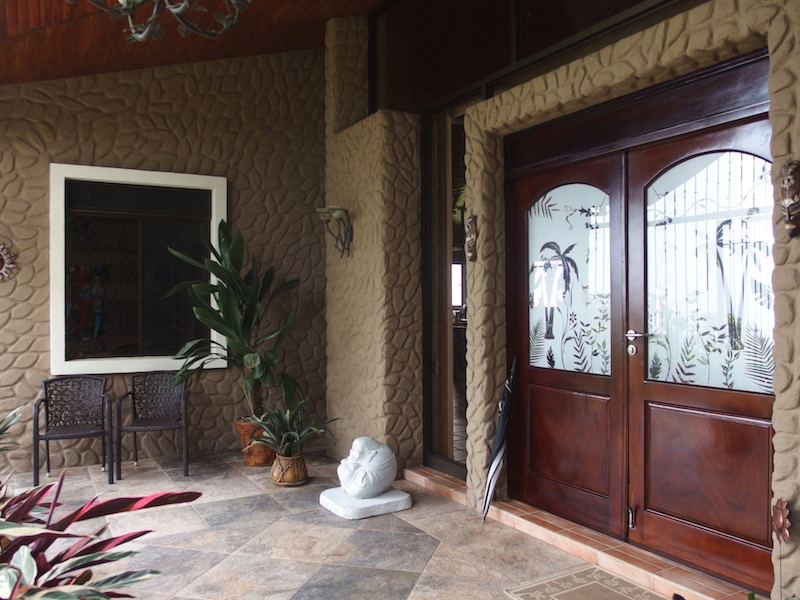 Lovely Double Doors lead into House form Covered Vestibule