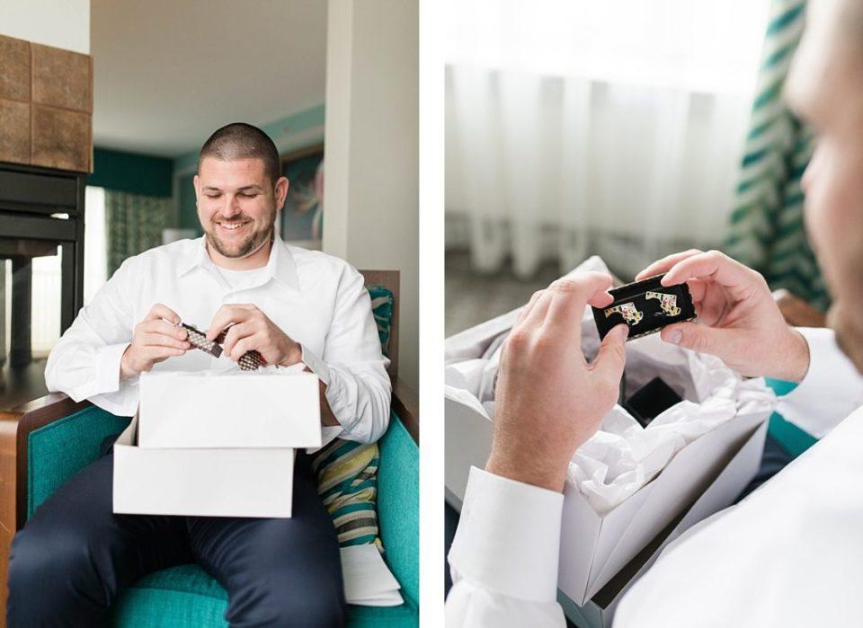 groom opening up cufflinks on his wedding day