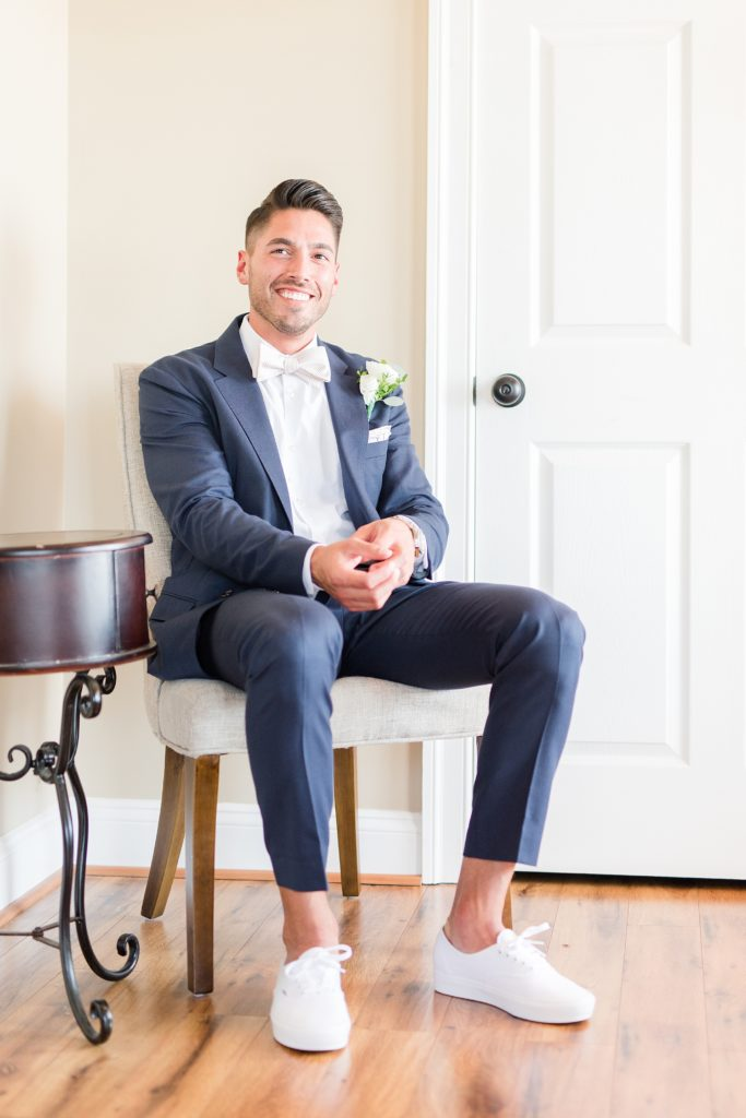 groom getting ready by costola photography