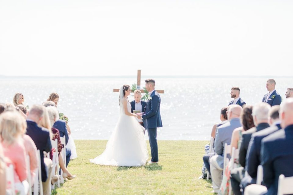 ceremony at weatherly waterfront farm photography by costola photography