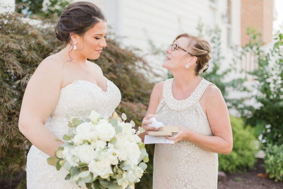 bride giving gift to mom at waterfront weatherly farm wedding by Costola Photography