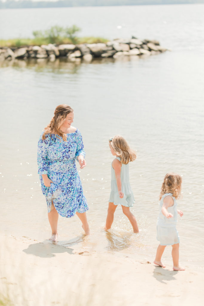 Girls playing in the water at Playful Beach Family Session in Southern Maryland by Costola Photography