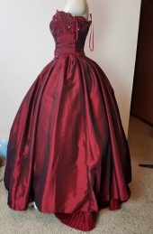 side of dress, pinning bottom ruffle.