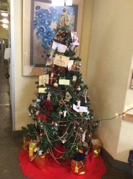 The adults at the Mary Isaak Center decorated the tree with letters to Santa