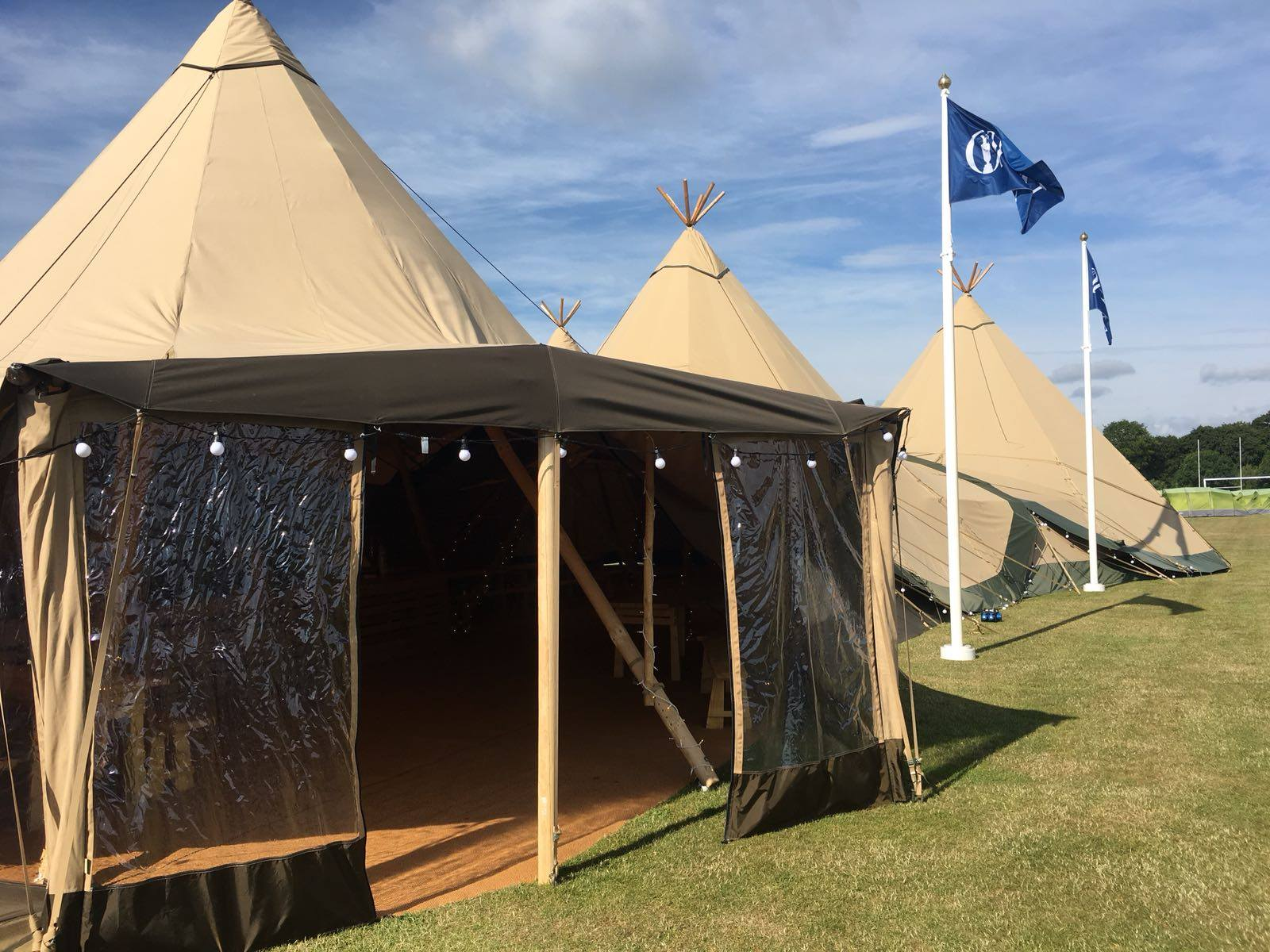 Welcoming entrance to the Giant Tipis Clubhouse at The Open Camping Village 2018