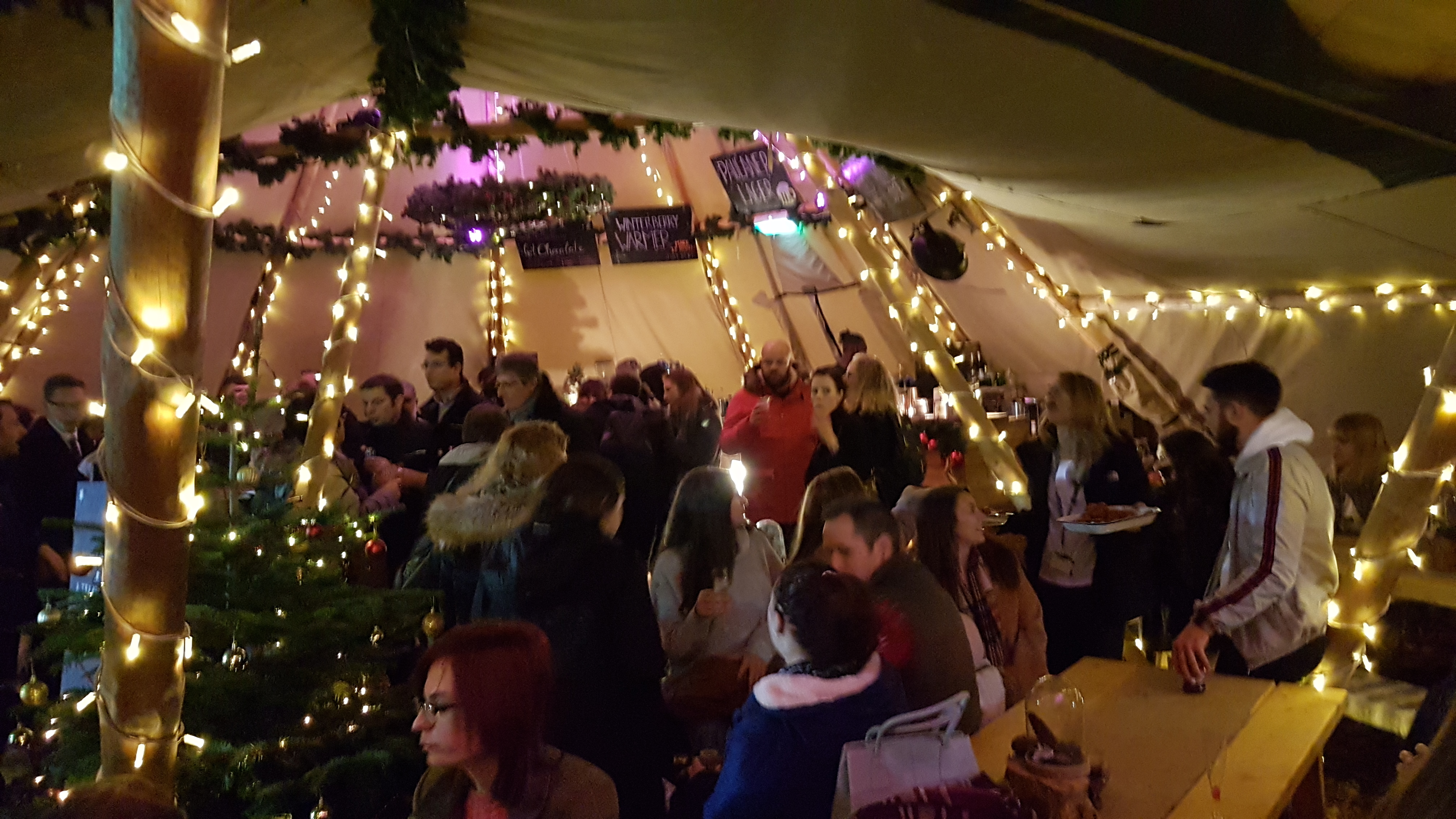 Customers enjoying the tipis at the Gloucester Quays Christmas Markets
