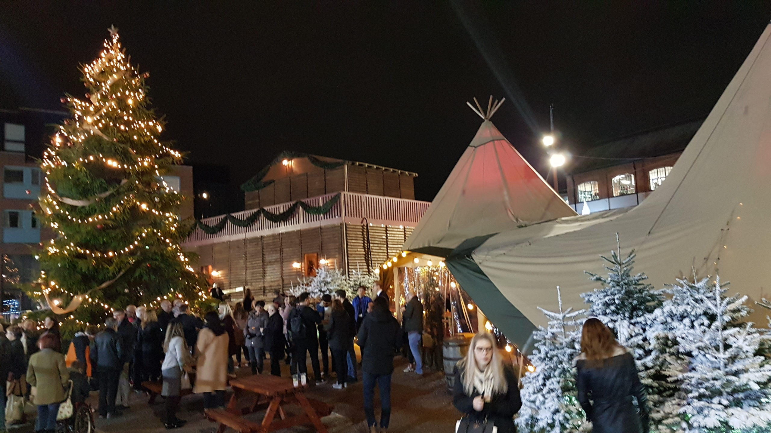 Image of two giant tipis next to 6 metre tall Christmas tree at the Gloucester Christmas Markets 2018.