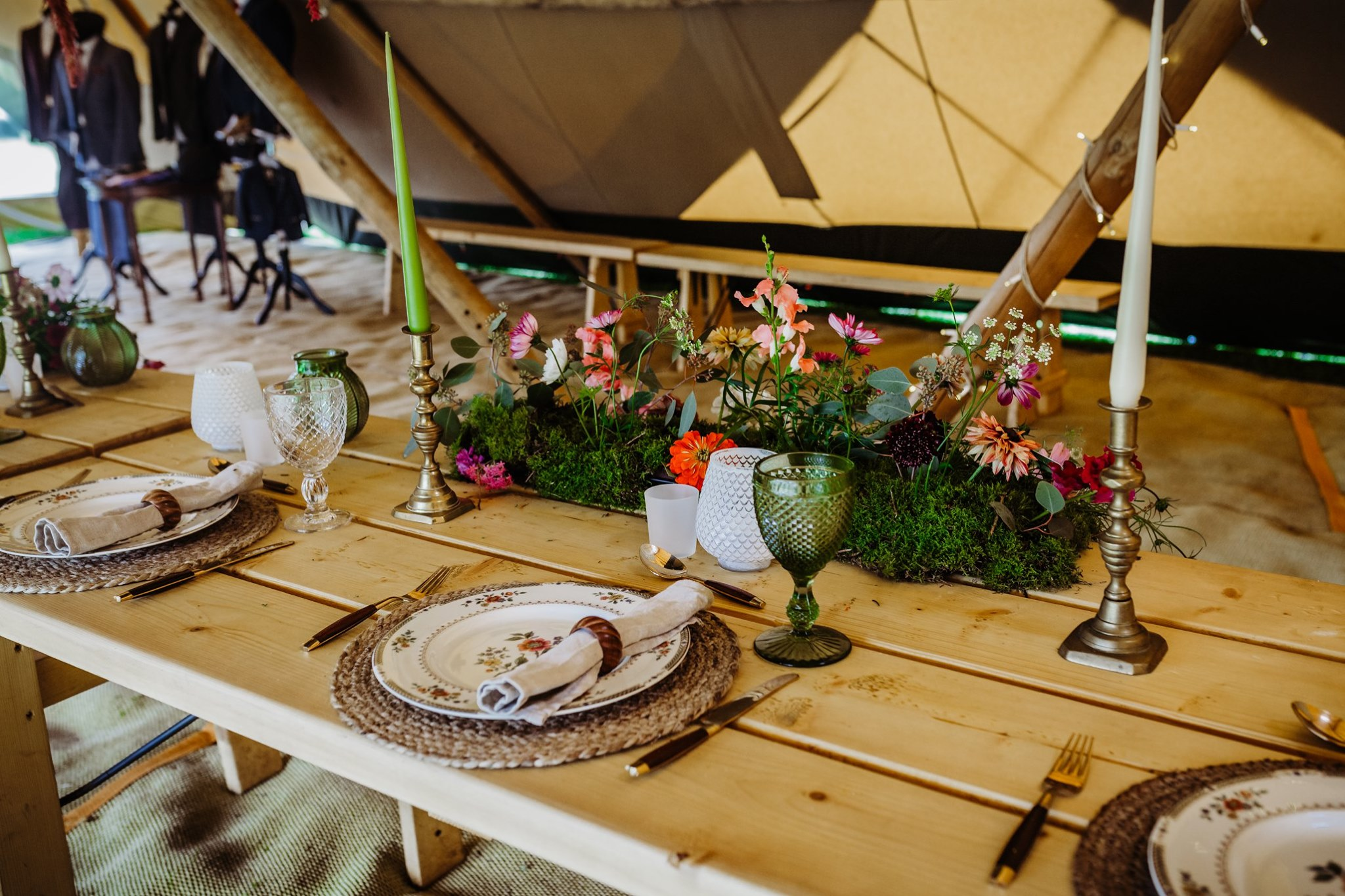Tipi wedding rustic table setting inspiration with wooden napkin holders, charming floral plates, glassware and candlesticks by Sally's Secrets prop hire
