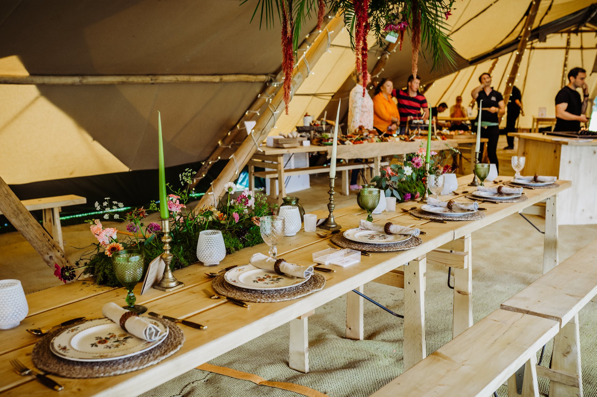 Head table in centre of Giant tipis with rustic table settings, long candle sticks and floral centre piece by The Lily Pad Florist
