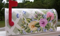 multicolored roses and flowers on a trellis background with butterflies