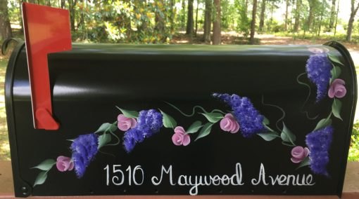 roses and wisteria on black hand painted mailbox