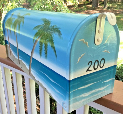 hand painted mailbox with nautical beach scene and palm trees