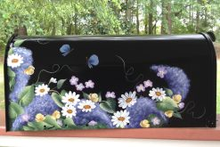 hand painted mailbox with daisies and butterflies