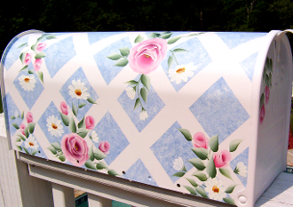 pink roses and daisies growing on a white lattice with sky blue background