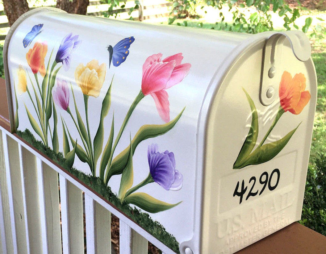 hand painted mailbox with tulips and butterflies