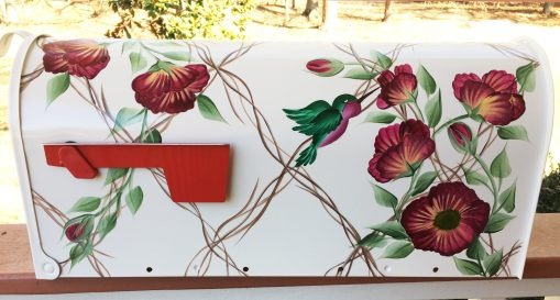 hand painted mailbox wild roses growing on a trellis with hummingbirds