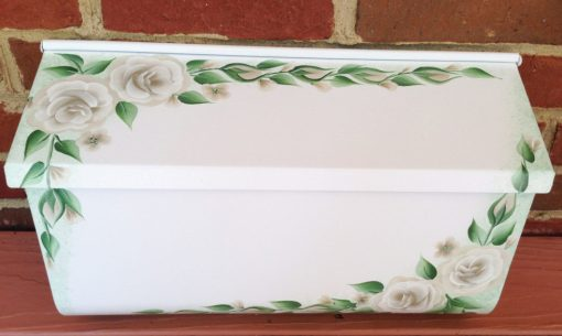 decorative hand painted mailbox with white roses