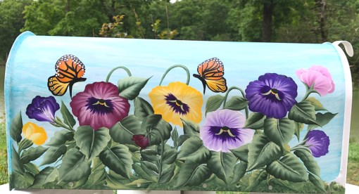hand painted mailbox with colorful pansies