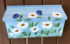 daisies painted on a sky blue background