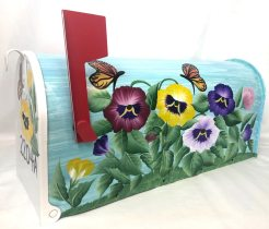 hand painted mailbox with pansy garden