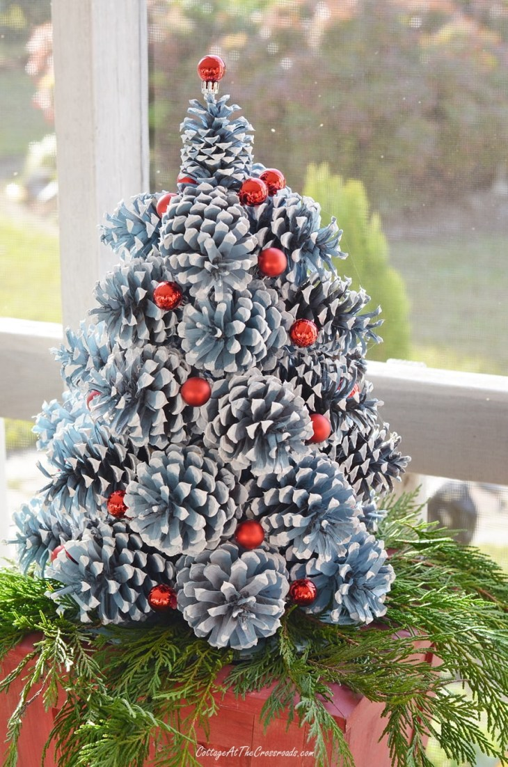 red miniature Christmas ornaments used on a pine cone Christmas tree