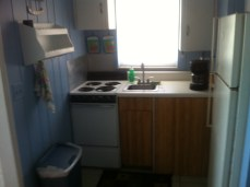 Four burner stove, sink, coffee pot and much more!