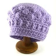 Purple, bobble, beret style beanie.