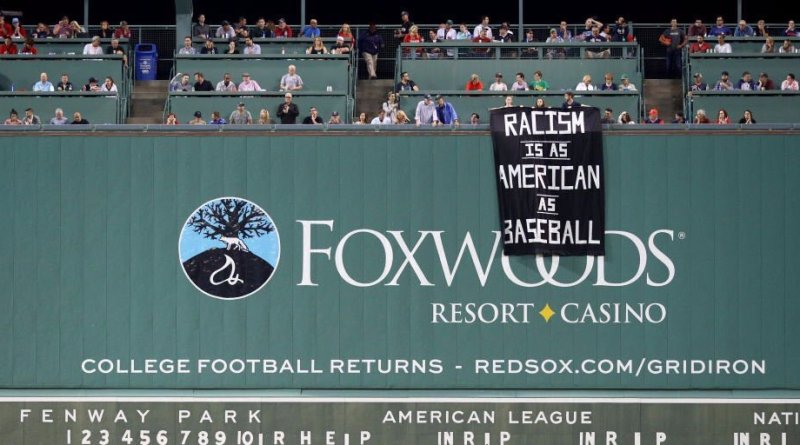 , Protesting Fans Hung This Banner Over the Green Monster During the Red Sox-Athletics Game Tonight