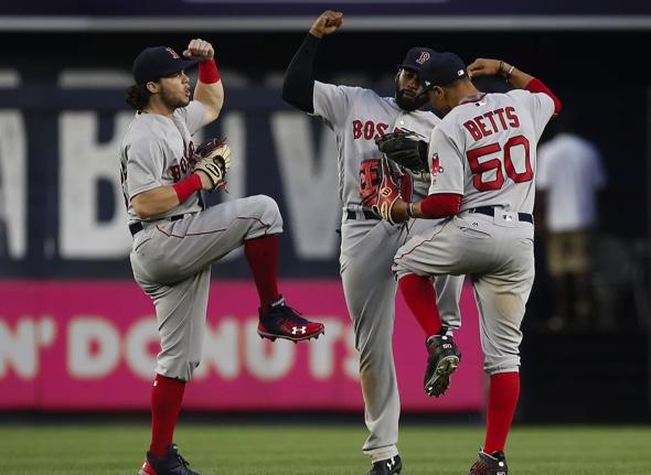 Red Sox Andrew Benintendi, Mookie Betts and Jackie Bradley Jr. celebrate following a win.