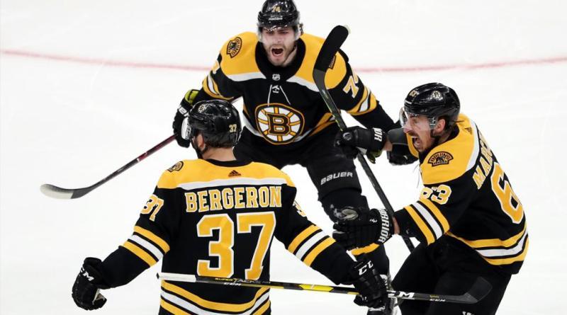 Boston Bruins players celebrate a goal