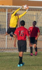 Eighth grader Thomas Duarte makes a leaping save on a close shot from an opposing player. The shot came from about 10 yards out and the save helped Cactus Canyon defeat Combs Middle School, 2-0. (This photo earned an Excellent Rating for photographer Megan Wagner.)