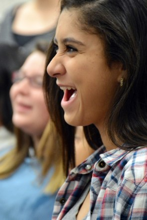Eighth grader Yesenia Wynn Nelson laughs while preparing her voice for choir class. Chorus members sing the ABC's at an increasing rate of speed every day to warm up before practicing their songs. (This photo earned an Excellent rating for photographer SeAnna Brennan.)