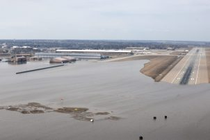 This image has an empty alt attribute; its file name is Offutt-Air-Force-Base_battling_flood_waters_190317-F-IT794-1053-1024x684.jpg
