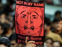 """New Delhi : A participant shows a placard during a silent protest """"Not in My Name"""" against the targeted lynching, at Jantar Mantar in New Delhi on Wednesday. PTI Photo by Shahbaz Khan(PTI6_28_2017_000215B)"""
